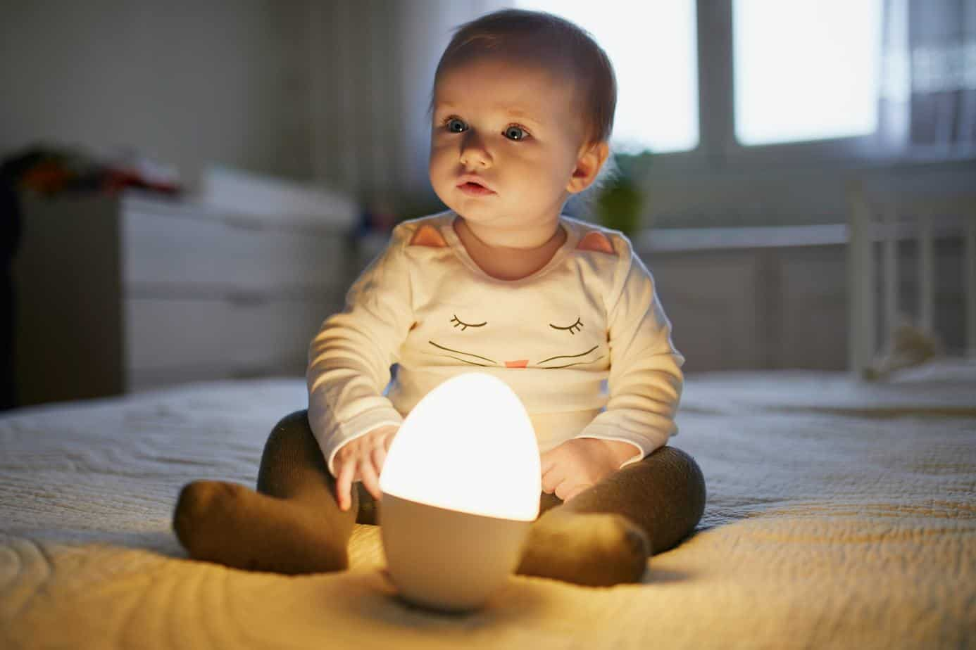 adorable baby girl with night light lamp