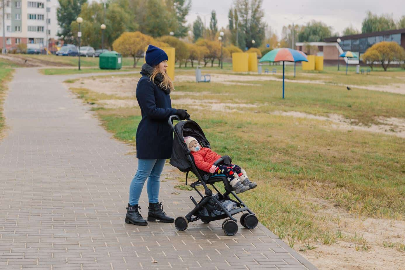 baby in gb pockit plus stroller and mother in the park