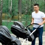 father pushing evenflo pivot xpand stroller