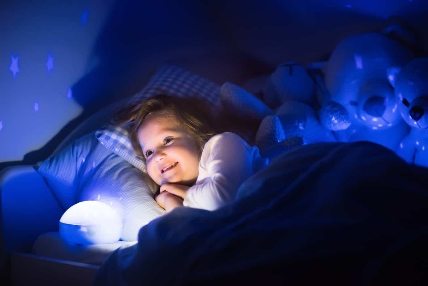toddler sleeping beside night light