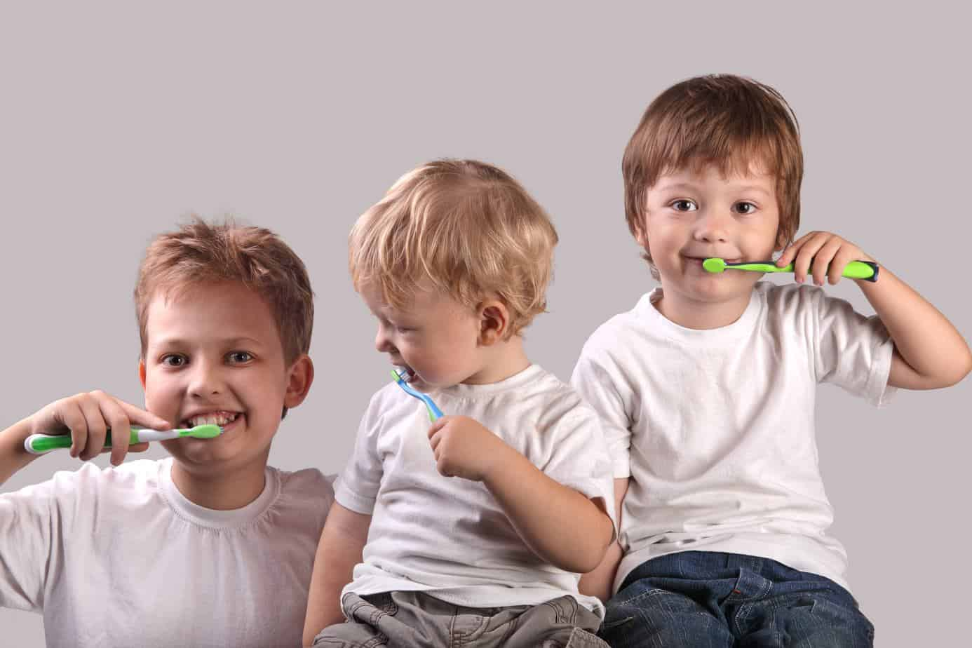 toddlers brushing their teeth together